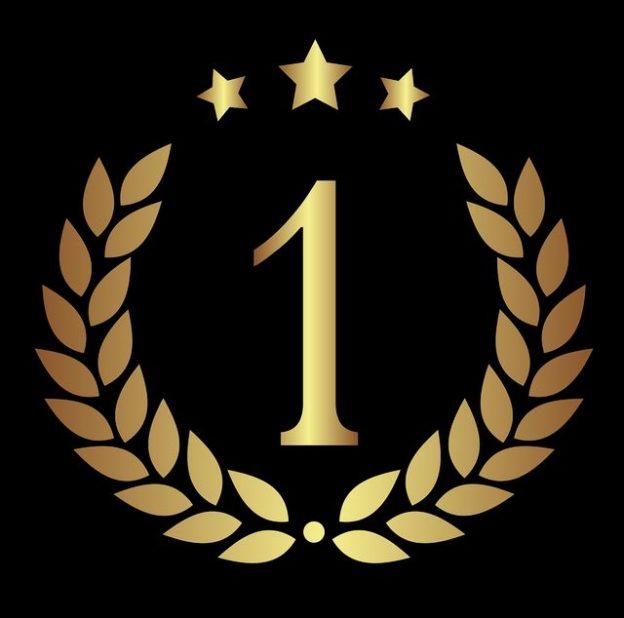 Le numéro 1 entouré d'une couronne de laurier et d'étoiles.